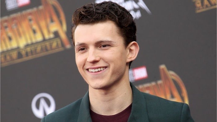 tom holland, green jacket, red shirt, cool hairstyles for men, brown hair