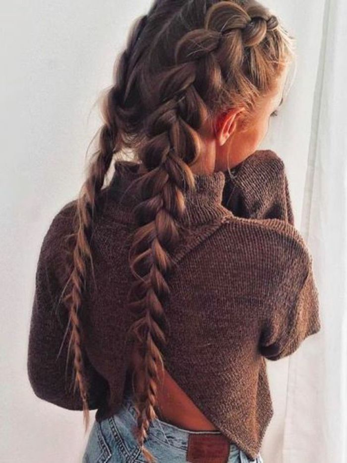 braid hairstyles for long hair, brown hair, two side braids, brown sweater, blue jeans