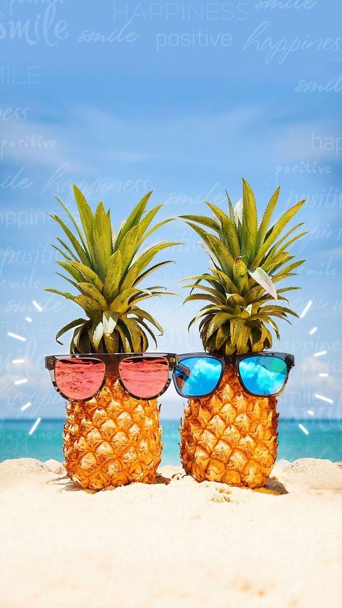 two pineapples, wearing sunglasses, cute computer backgrounds, in the beach sand