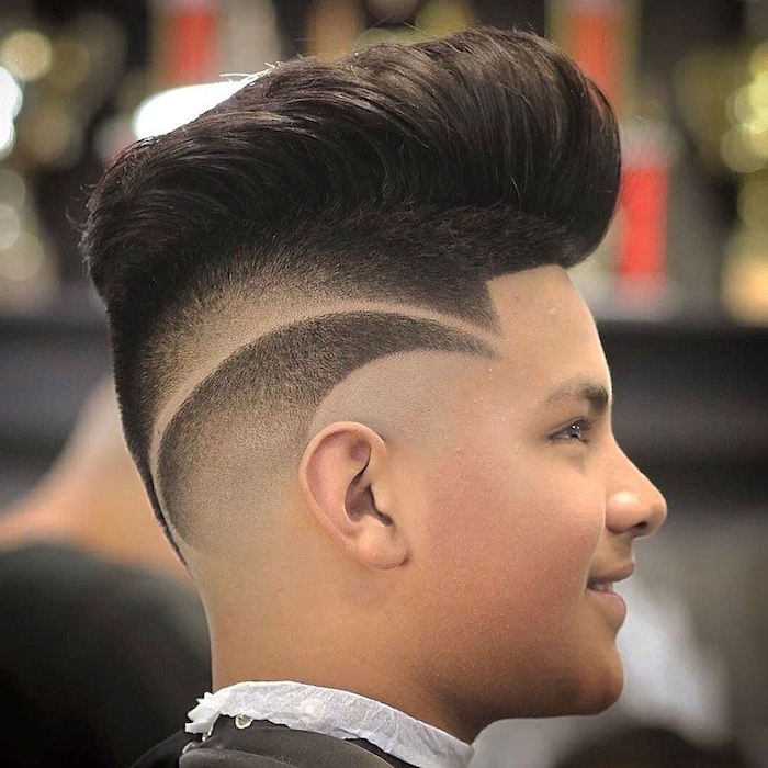 best haircut for boys, black hair, long top, blurred background