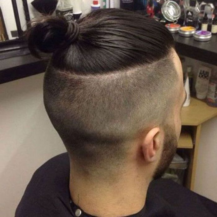 black hair undercut, shaved sides, long top, in a bun, hairstyles for men with thick hair