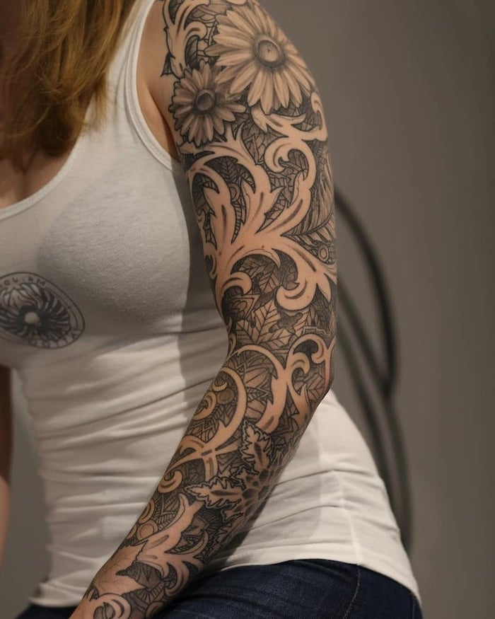 white top, floral tattoo, tribal sleeve tattoos, white background