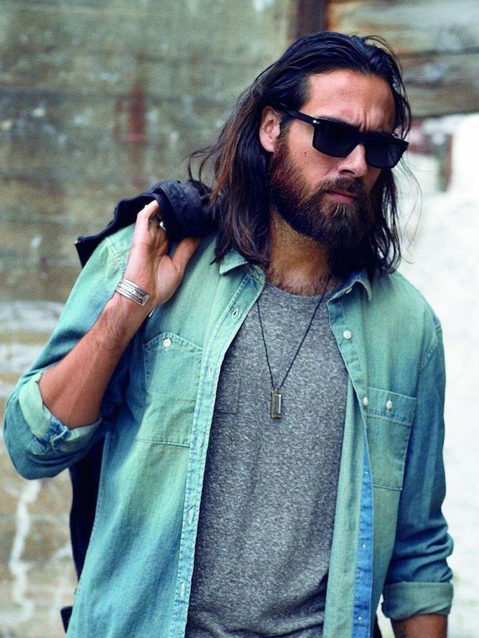 black hair, wavy hairstyles for men, denim shirt, grey shirt, man with sunglasses