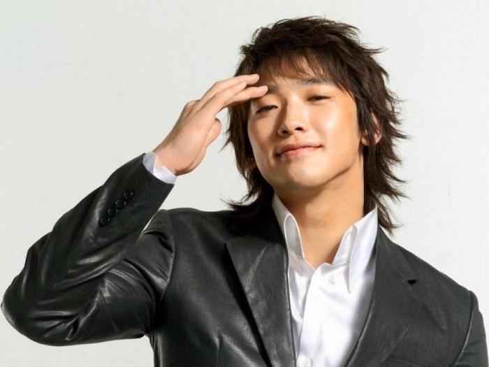 brown hair, medium length, wavy hairstyles for men, black leather blazer, white shirt