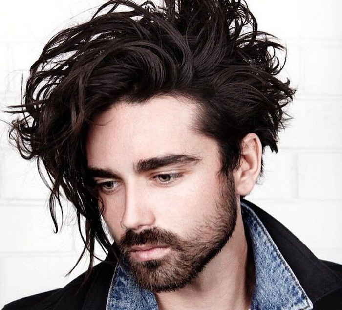 black messy hair, wavy hairstyles for men, denim jacket, white background