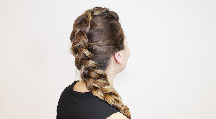 how to do a waterfall braid, brown hair, blonde highlights, black top, white background