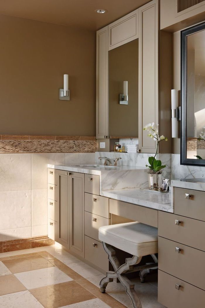 makeup vanity table with lighted mirror, beige drawers, marble countertop, white leather stool