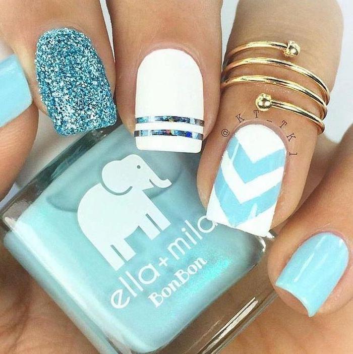 white and blue, blue glitter, nail polish, classy nail designs, gold ring, nail polish bottle
