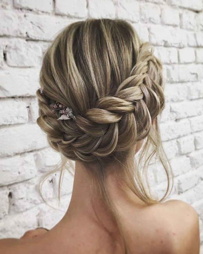 white brick wall, how to do a waterfall braid, blonde hair, with highlights, braided updo