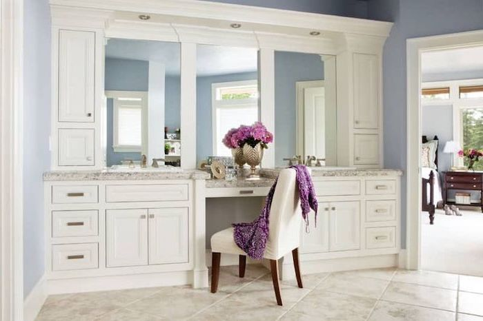 large mirror, white cupboards and drawers, vanity mirror with lights for bedroom, white chair