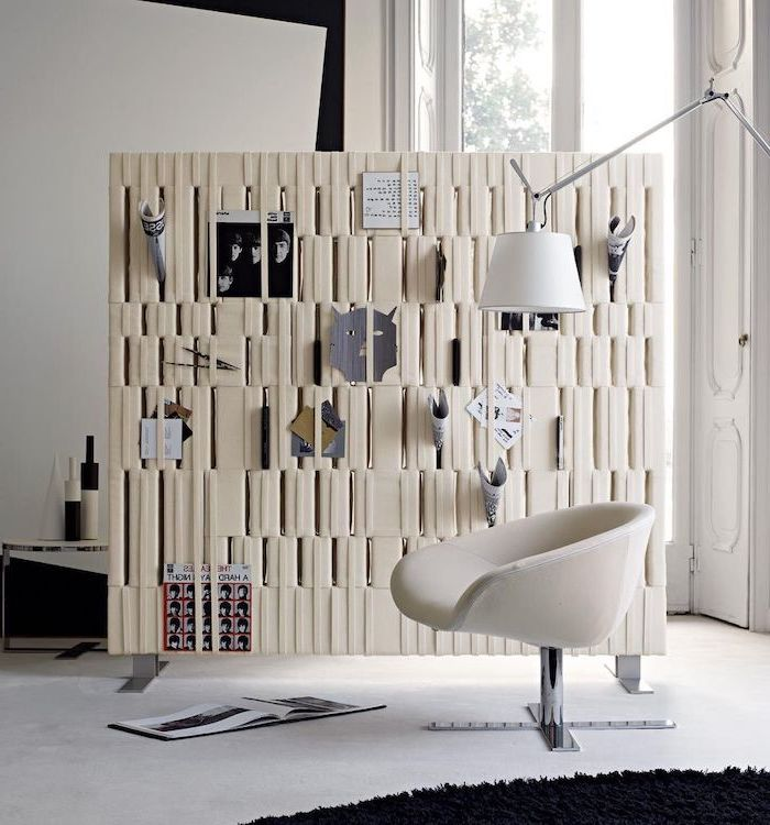 white leather panel, covered in magazines and vinyl, room divider doors, white armchair