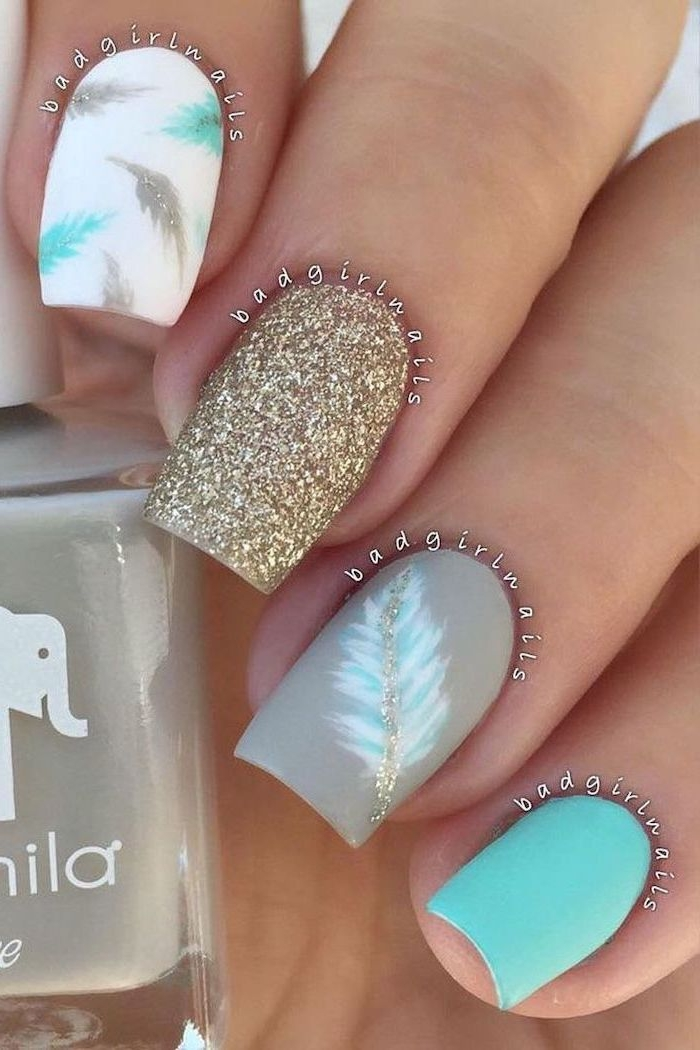 blue white and grey, matte nail polish, gold glitter, blue and gold feathers, classy nail designs