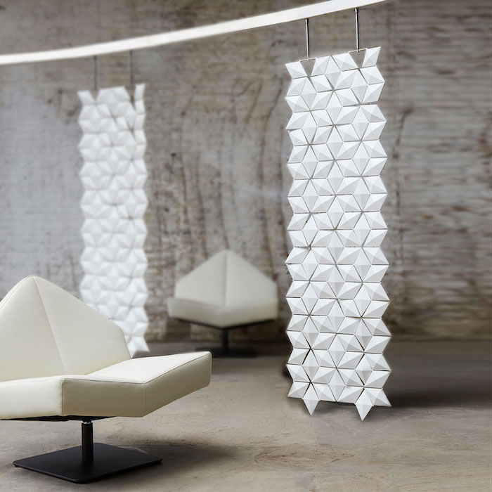 geometrical hanging panels, room divider doors, white armchairs, industrial style