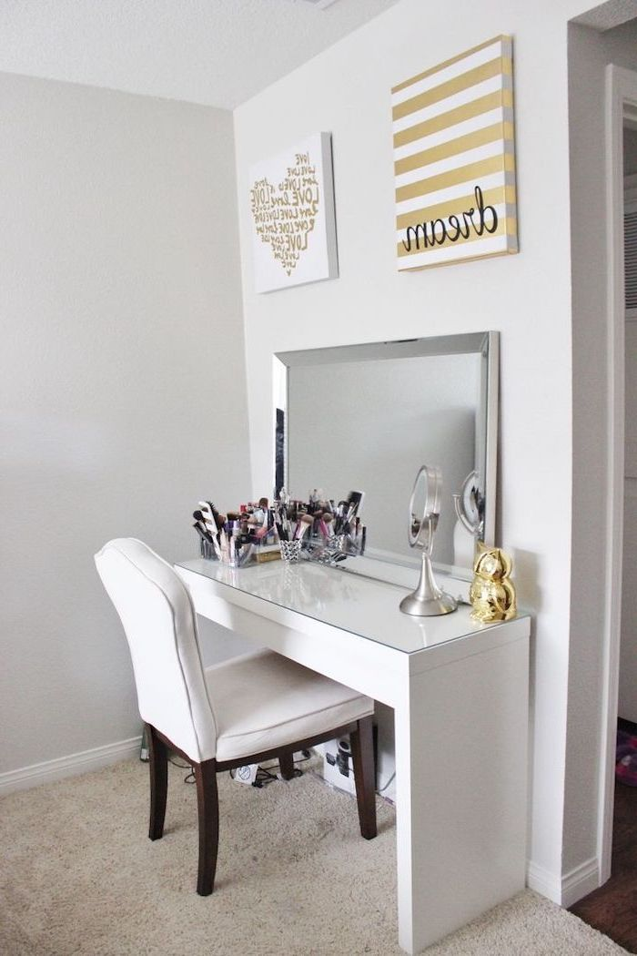 white chair, white table, vanity mirror with lights for bedroom, white walls, beige carpet