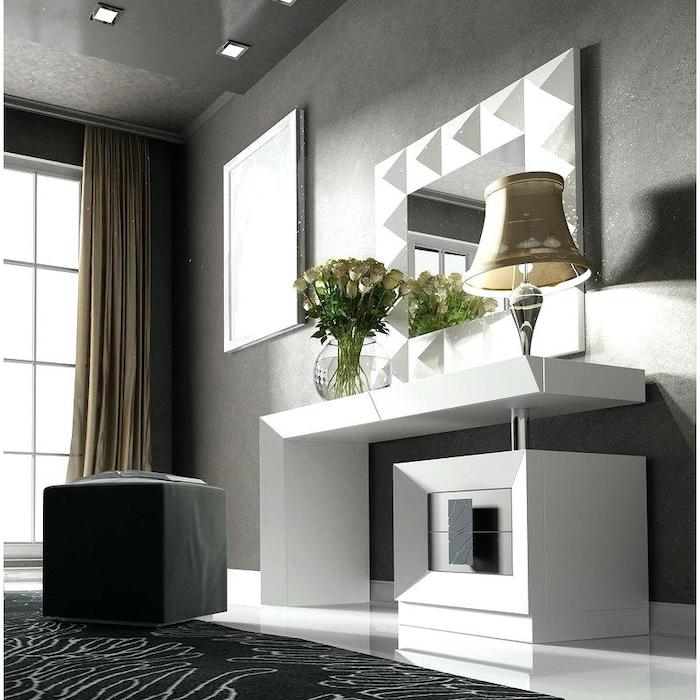 grey walls, black leather ottoman, white shelf, modern makeup vanity, black carpet