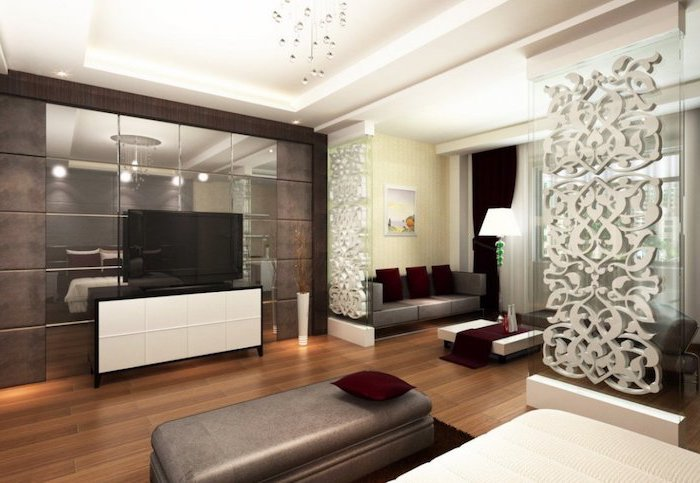 mirror panels, glass floral panels, room divider doors, grey sofa, grey ottoman, wooden floor