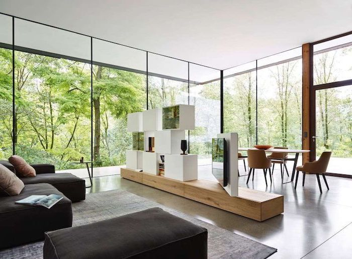 tall windows, black corner sofa, black ottoman, dining table, rotating tv and bookshelves, room divider doors