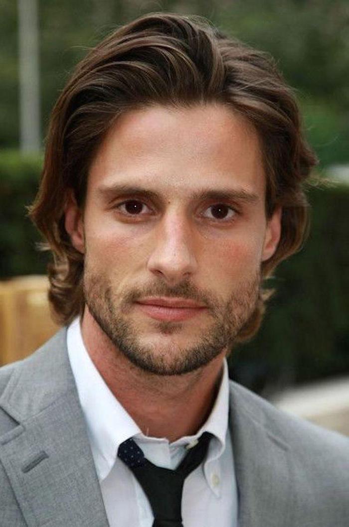 long hairstyles for guys, brown hair, medium length, grey blazer, white shirt, black tie