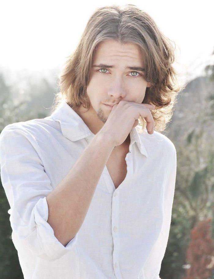 blonde hair, blue eyes, white shirt, hairstyles for men, blurred background