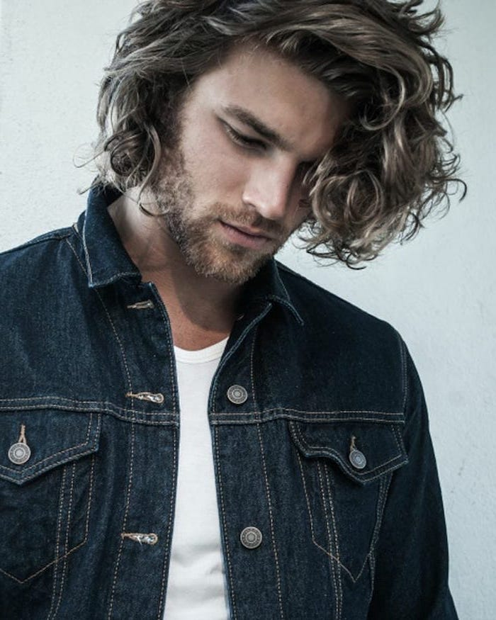 denim jacket, blonde curly hair, long hairstyles for guys, white shirt, white background
