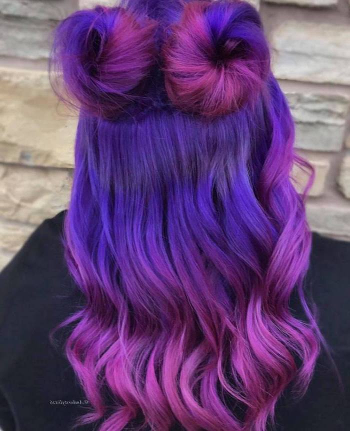 purple to pink, in two buns, long wavy hair, brown and blonde ombre, white stone wall