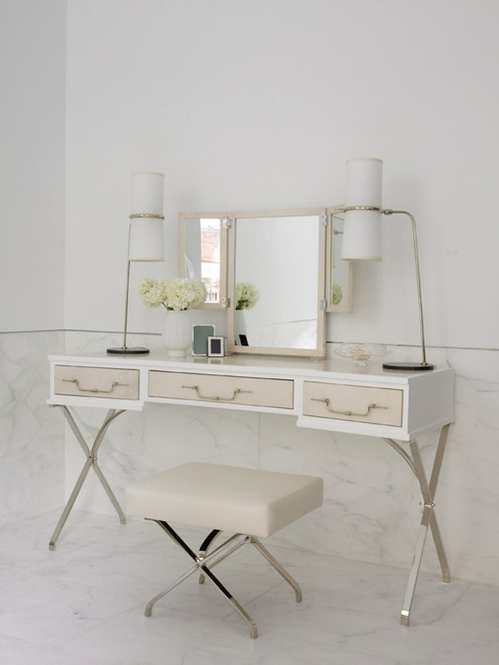white walls, marble floor, modern makeup vanity, white with beige drawers, beige leather stool