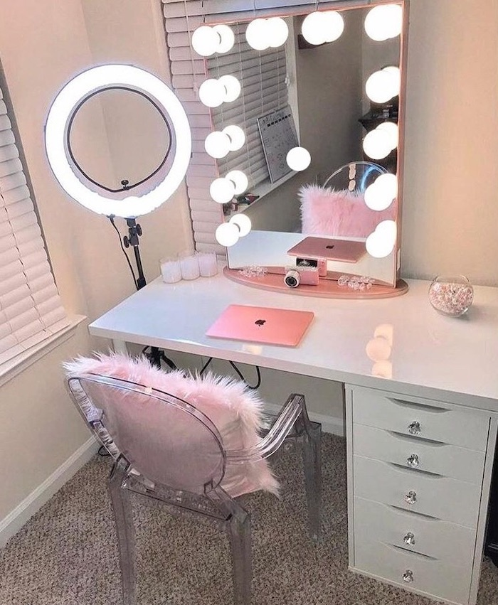 mirrors with lights, white table, bathroom makeup vanity, acrylic chair, pink furry throw pillow