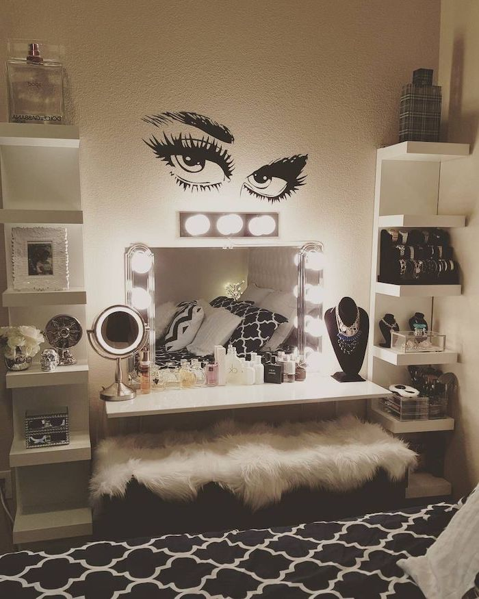 mirror with lights, floating white shelves, full of makeup, dressing table with drawers, white furry cover