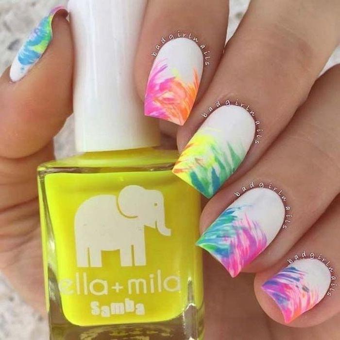 white nail polish, rainbow colored brush strokes, cute gel nails, nail polish bottle