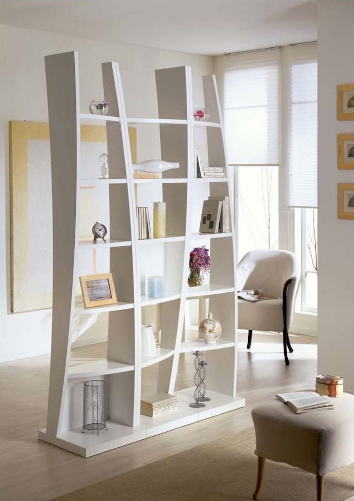 white bookcase, wooden floor, white armchair, white ottoman, folding screen room divider