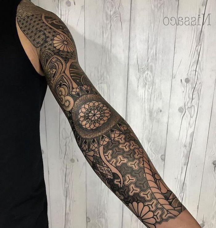 half sleeve tattoo ideas, tribal tattoo, wooden background, black top