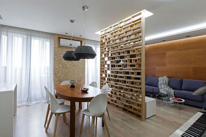 wooden blocks, folding screen room divider, blue sofa, wooden wall, mosaic wall, wooden floor, white chairs