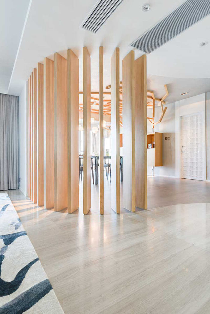 tall wooden panels, folding screen room divider, wooden floor, white and black carpet, grey curtains