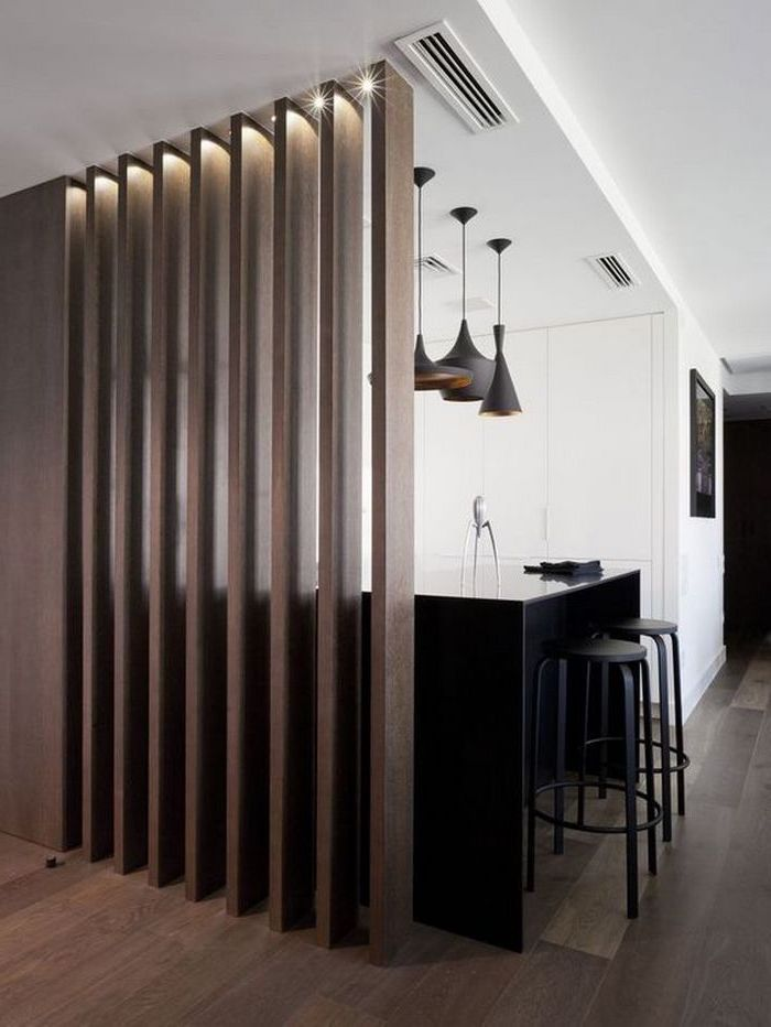 wooden panels, kitchen island, black metal bar stools, indoor privacy screen, wooden floor