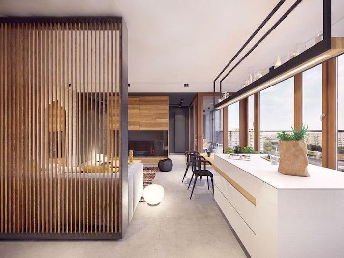 wooden poles, arranged together, decorative room dividers, kitchen island, black chairs, wooden wall