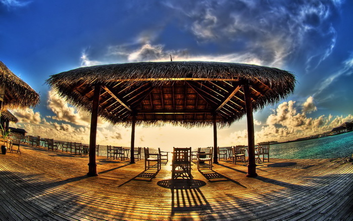 wooden tent, wooden chairs and tables, cool wallpapers, blue sky, next to the water