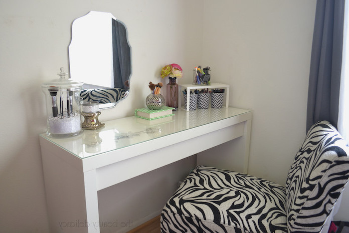 zebra printed chair, white table, small mirror, makeup brushes, dressing table with drawers