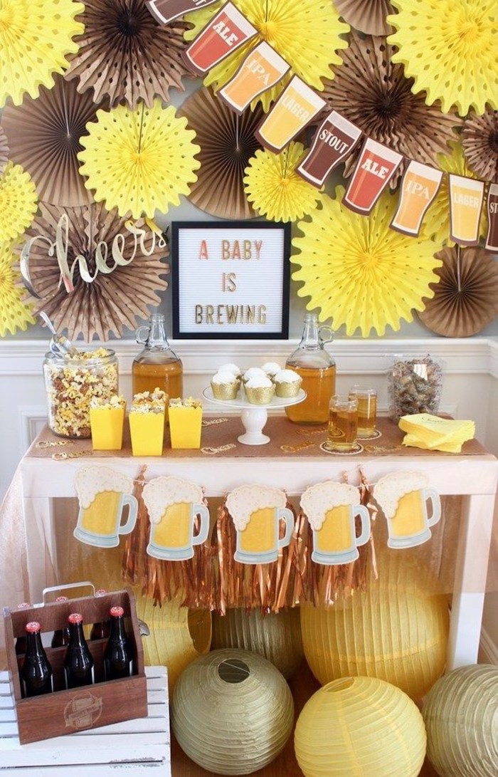 a baby is brewing, beer theme, baby shower decoration ideas, brown and yellow decor, cupcakes and popcorn