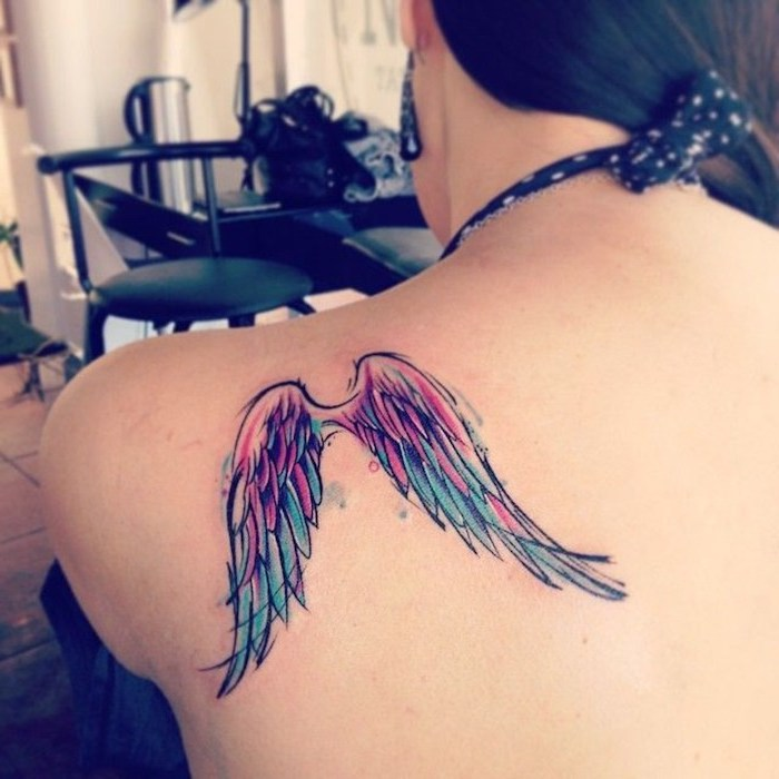 watercolor tattoo, angel wings tattoo, shoulder tattoo, woman with black hair, black earrings