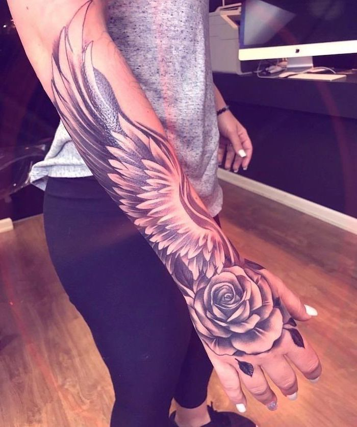 wings and rose, woman with grey top, black tights, angel wings tattoo, wooden floor