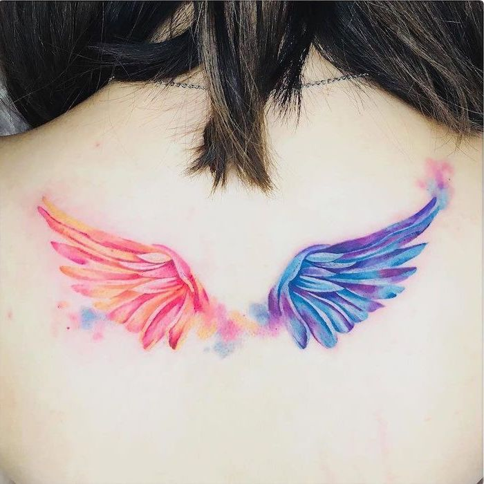 watercolor tattoo, back tattoo, angel wings tattoo, blue and purple wing, orange and pink wing