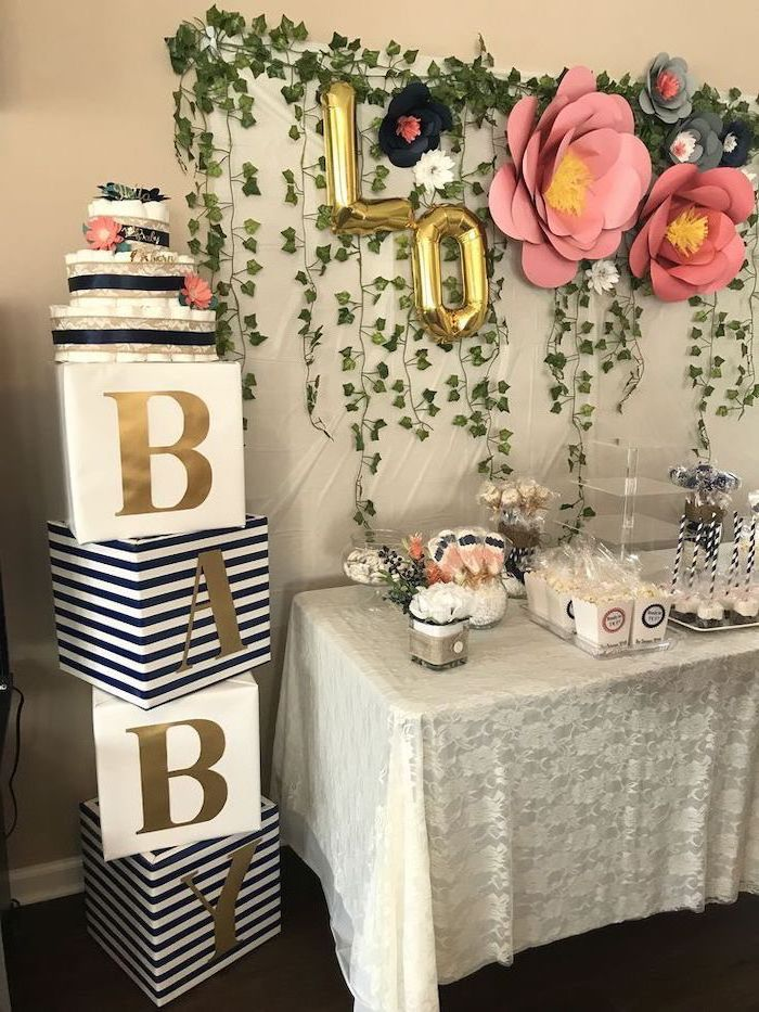 large paper flowers, greenery decor, baby shower decoration ideas, cake pops, popcorn in a cup, white table cloth