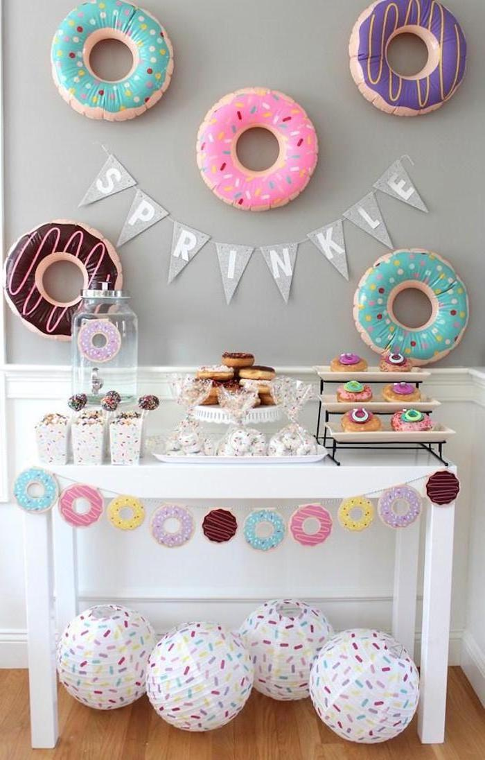 sprinkle garland, donuts theme, donut balloons, baby shower decoration ideas, white wooden table, dessert table