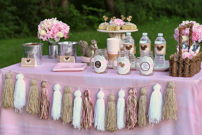 tassel garland, rustic decor, pink brown and white, baby shower decoration ideas, water bottles, cinnamon buns