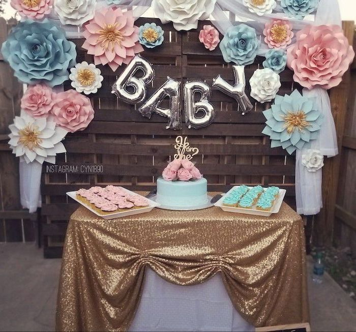 pink and blue flowers, dessert table, cake in the middle, cupcake trays, unique gender reveal ideas