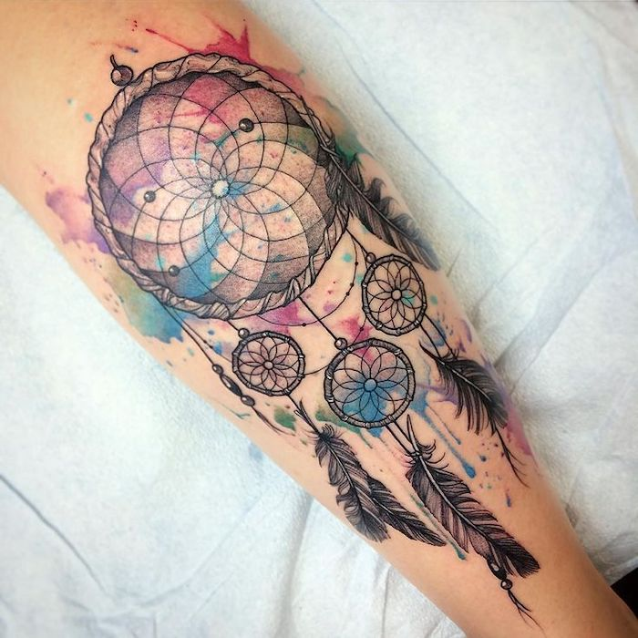 dream catcher tattoo, watercolor tattoo, back of leg, on white sheet of paper