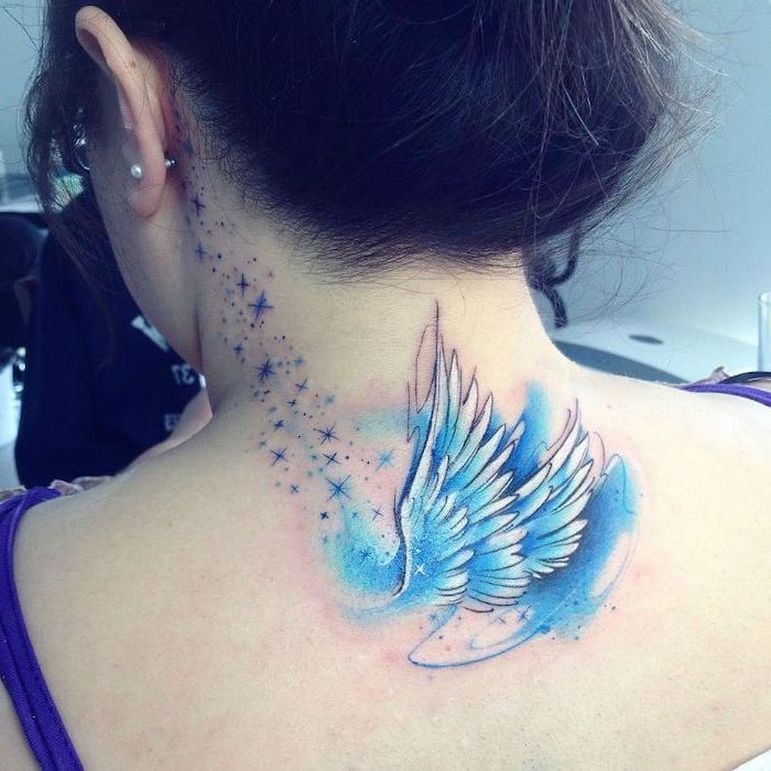 woman with brown hair, guardian angel tattoo, watercolor tattoo, blue color, back tattoo, stars tattoo behind the ear