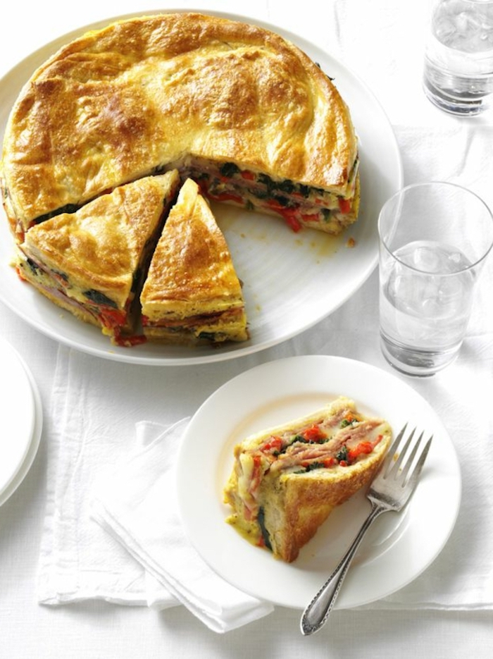 breakfast potluck ideas, baked casserole, with ham and tomatoes, white plate, water glasses