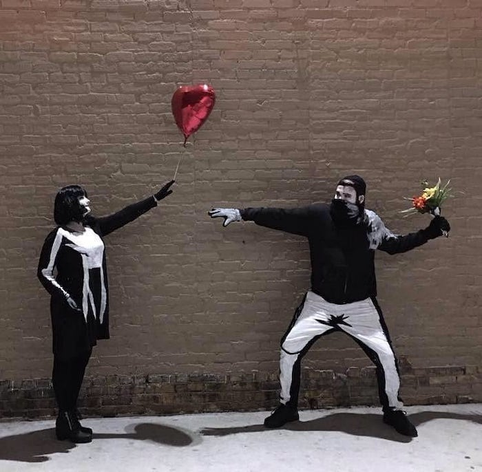 banksy art inspired, last minute halloween costumes, girl with balloon, man with flowers, brick wall