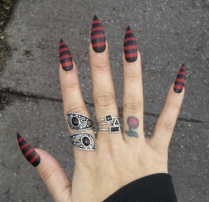 black and red, matte nail polish, candy corn nails, striped nails, long stiletto nails, silver rings, cherry finger tattoo